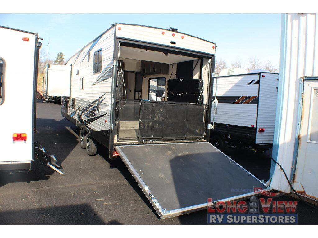 Travel trailer toy hauler garage