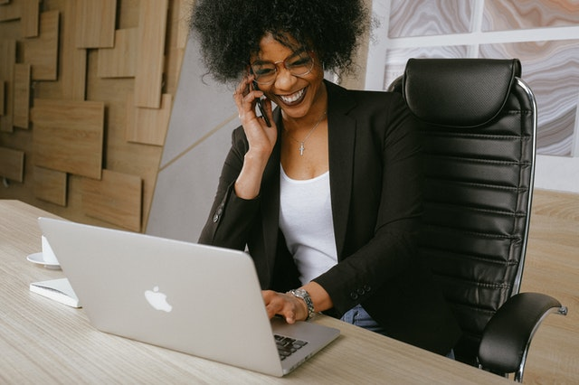 Woman on laptop happy
